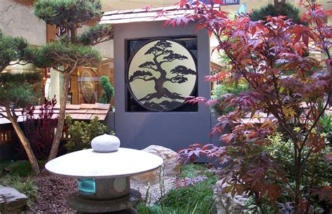 small space japanese garden with green plants and