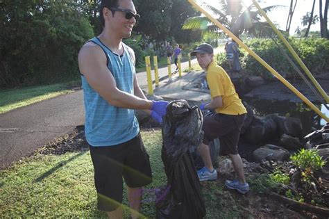 community volunteers clean  pearl harbor bike path