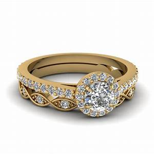 Round cut diamond wedding ring sets in 14k yellow gold for Wedding ring engagement ring set