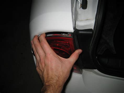 how to replace headlight bulb for 2012 chevy malibu