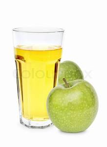 Green apple with glass of apple juice over white ...