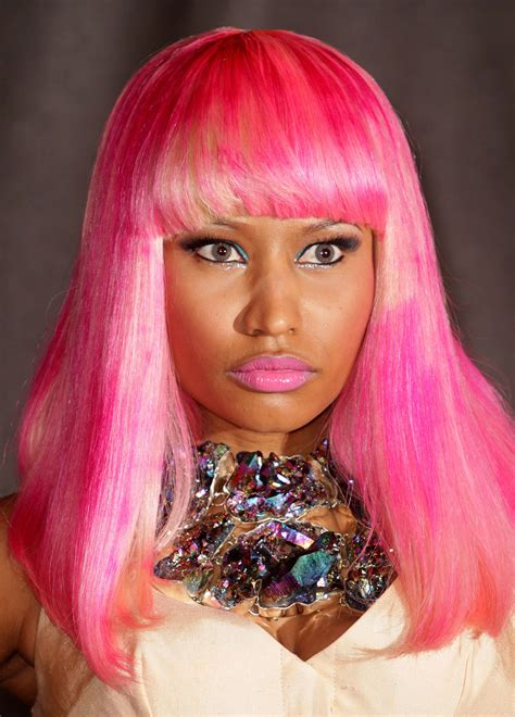 Nicki Minaj Shows Of 12 Of Her Colourful Wigs Pictures