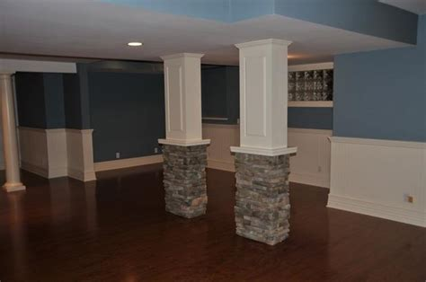 transitional basement  danbury white columns white