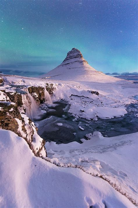 Northern Lights Appear Over Mount Kirkjufell In Iceland