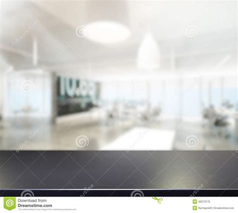Tischplatteund Unschärfebürohintergrund Stockfoto