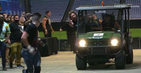 wrestlers ran   opponent   golf cart