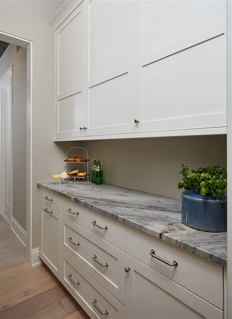 best benjamin moore white for cabinets coastal beach house for sale home bunch interior design 315 | Best neutral wall and cabinet paint color for any kitchen style and any kitchen size Wall paint color is Benjamin Moore Revere Pewter and cabinet paint color is Benjamin Moore White Dove.