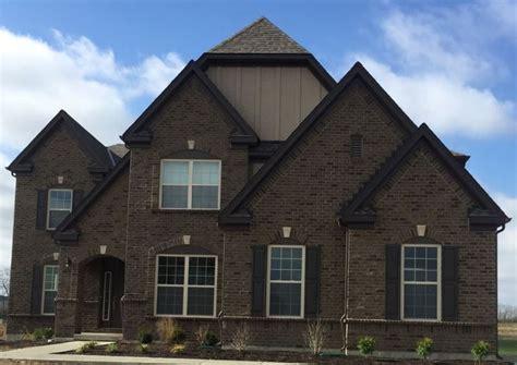 manor house tudor brick with khaki brown horizontal hardi siding musket brown trim and musket