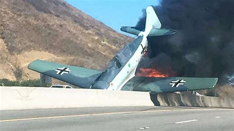 Vintage Plane Erupts In Flames After Crashing Onto Freeway