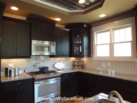 dark kitchen cabinets with light countertops dark cabinets light granite countertops and grey vertical