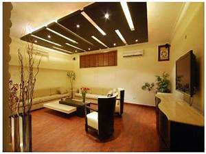awesome unique shape wooden false ceiling designs for With design of ceiling in living room