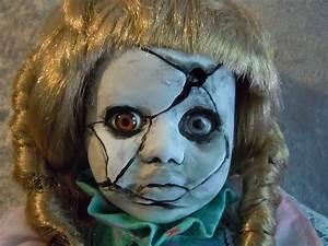 Creepy cracked face scary doll