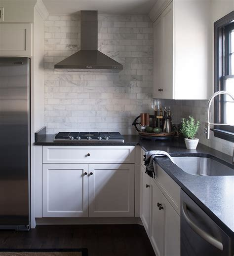 kitchen cabinets with black granite countertops the flip side of tradition transforms a 9831