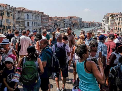 venice italy crowd cruise tourists bridge stand divert ships center rialto aug