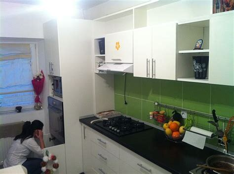 Reader's Project:Green kitchen backsplash and white cabinets
