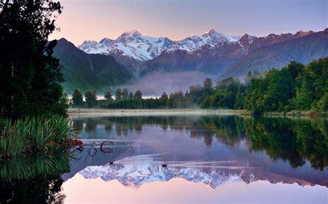 beautiful nature lake reeds trees gassing mountains