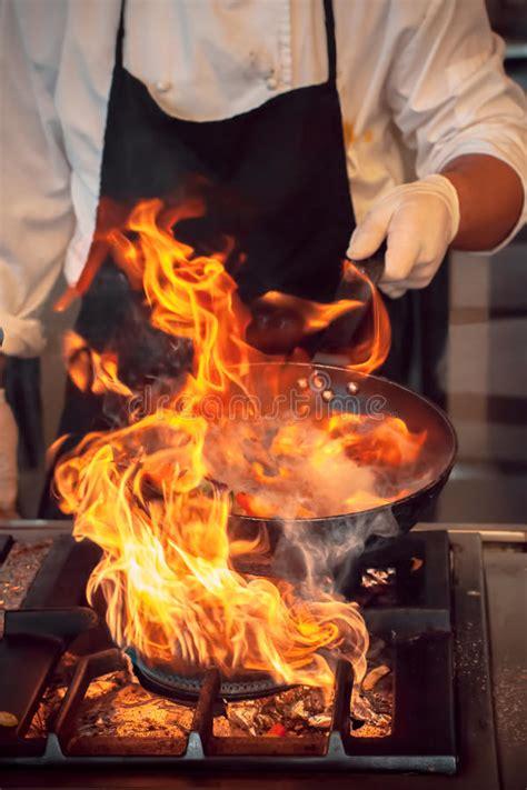 fire burn cooking  iron pan stock photo image