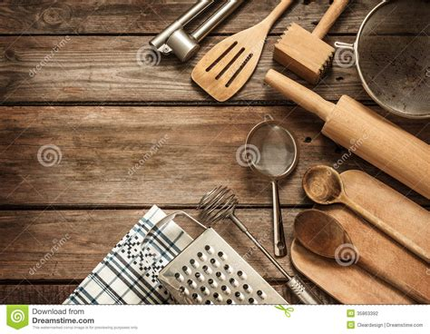 rural kitchen utensils  vintage planked wood table stock