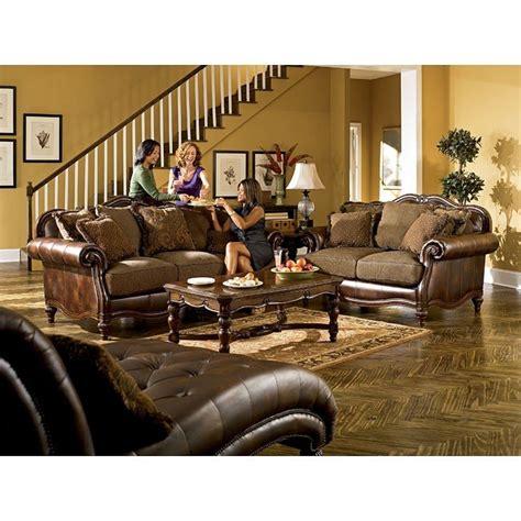 claremore antique sofa loveseat set claremore antique living room set by signature design by