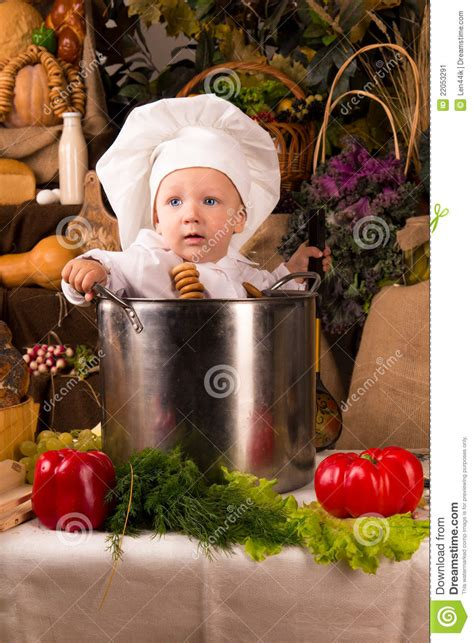 baby wearing  chef hat   cooking stock pot stock