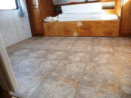 vinyl flooring quarter use quarter round to trim all edges after installing floating vinyl tiles on the road