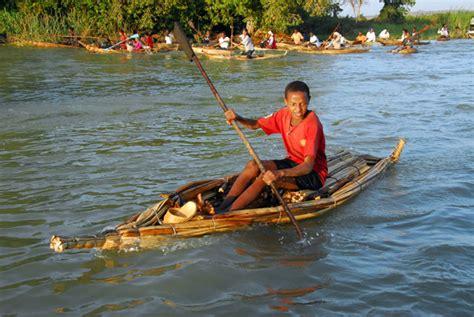 Boy padding a Tankwa (papyrus reed boat) Lake Tana photo ...