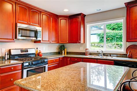 bright kitchen room  cherry wood storage combination