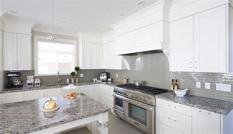 white cabinets grey glass backsplash and med grey granite