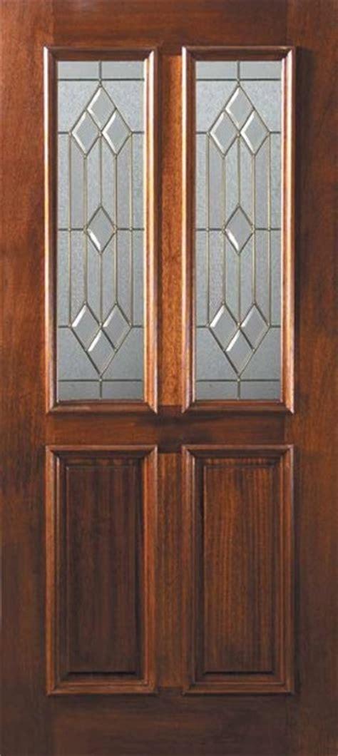 slab front single door  mahogany dover  panel twin lite