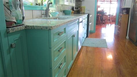 floating blue vetrazzo  teal cabinetry eclectic