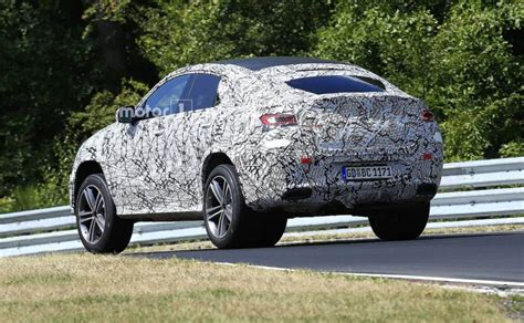 Sporty amg steering wheel, carbon fiber trim lift ambiance. 2020 Mercedes-Benz GLE Coupe Spotted Testing At Nurburgring - carandbike