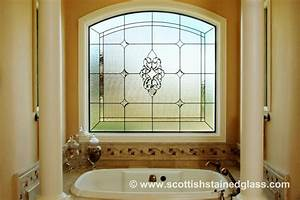 Stained glass arched bathroom window for Bathroom window glass styles