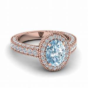 vintage oval shape aquamarine halo engagement ring in 14k With rose colored wedding rings