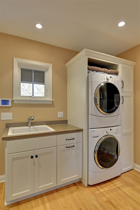 stackable washer and dryer laundry room traditional with