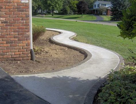 winding broom finish standard concrete walkway with