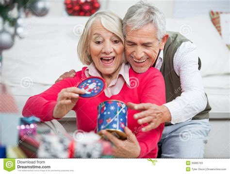 Surprised Senior Woman With Man Looking At Stock Image