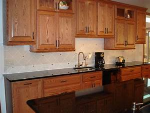 kitchen kitchen backsplash ideas black granite With kitchen cabinets lowes with silver and gold wall art