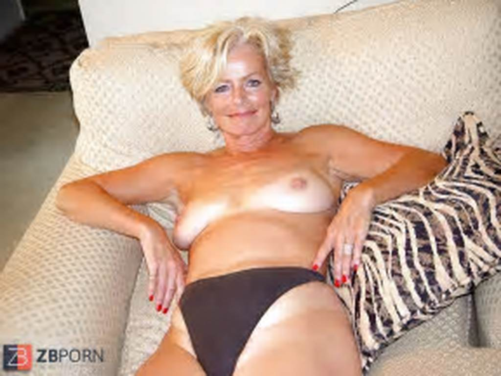 #Justine #A #Mature #Blonde #Posing #In #The #Living #Room #21
