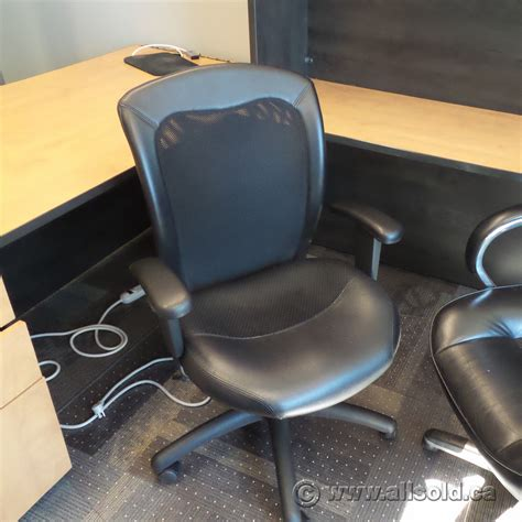 black leather mesh back rolling task chair with arms