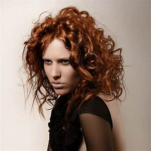 Hairstyle with wild copper colored curls and messy styling  Curly