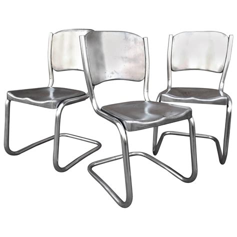set of eight tubular brushed steel dining chairs for sale