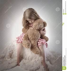Sad Little Girl Holding Teddy Bear Stock Photo - Image ...
