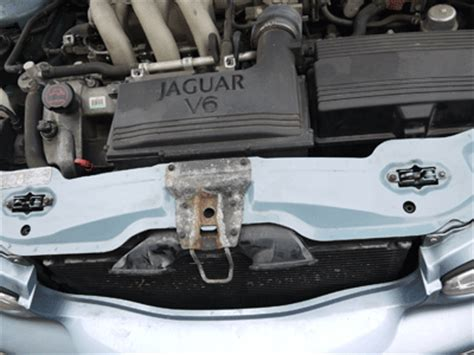 replace hood release cable    jaguar xj series