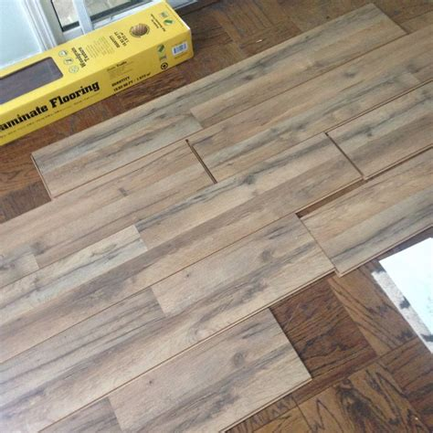 lowes flooring tavern oak all things new interiors tavern oak laminate from lowe s for the home pinterest all things