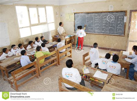 Students In Classroom Explaining Answer On Blackboard Editorial Stock Image  Image Of Educator