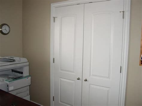 bedroom closets are doors which open wide for easy