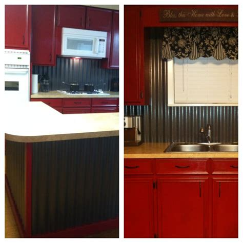 corrugated tin backsplash island  barn red cabinets
