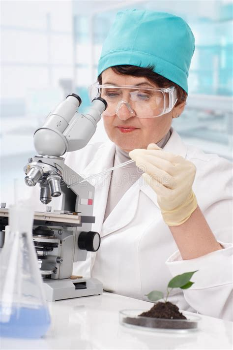 Woman Biologist Working With Microscope Stock Photo ...