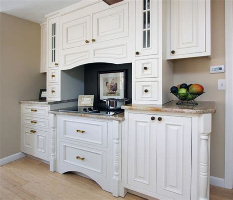 Wood Dover White Cabinets by Wayside Kitchens