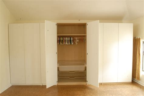 white wooden walk in closet with folding door and wire